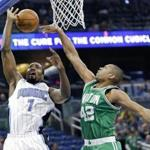 Orlando Magic's Serge Ibaka (7) is fouled as he goes to the basket against Boston Celtics' Al Horford (42) during the first half of an NBA basketball game, Wednesday, Dec. 7, 2016, in Orlando, Fla. (AP Photo/John Raoux)